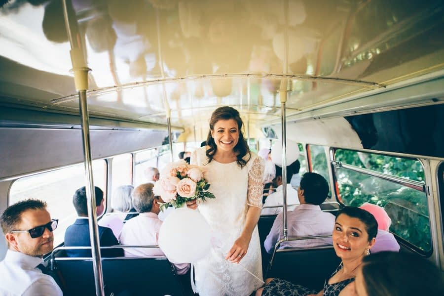 Bride on red bus, Bingham Riverhouse Wedding Photographer, Richmond Upon Thames, Surrey Wedding Photographer, Female Wedding Photographer