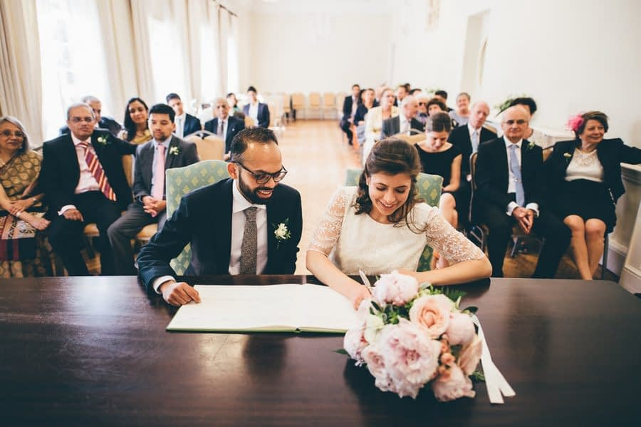 Couple Signing Wedding Register at York House Richmond, York House Wedding Photographer, Richmond Upon Thames, Surrey Wedding Photographer, Female Wedding Photographer