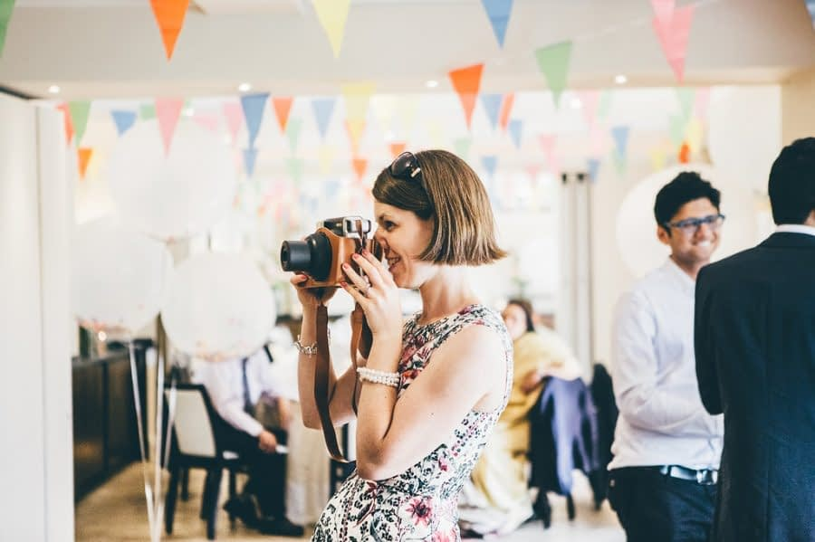 Wedding Guest with Camera, Bingham Riverhouse Wedding Photographer, Richmond Upon Thames, Surrey Wedding Photographer, Female Wedding Photographer